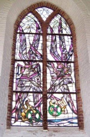 Ezechiël 1:16-21 afgebeeld op raam Catharinakerk te Zoutelande