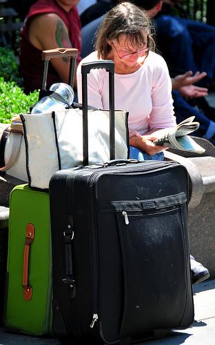Vrouw met veel bagage