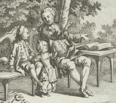 Man wijst naar een bijbel. Er zijn twee kinderen bij hem.